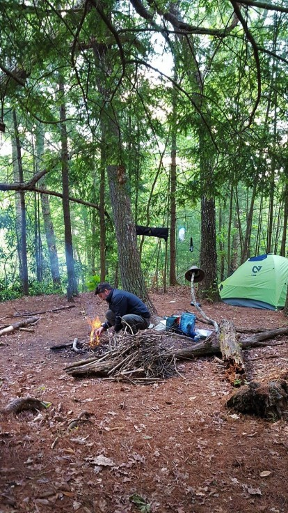 Campsite & Russell making a fire