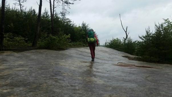 Elizabeth walking on the rock